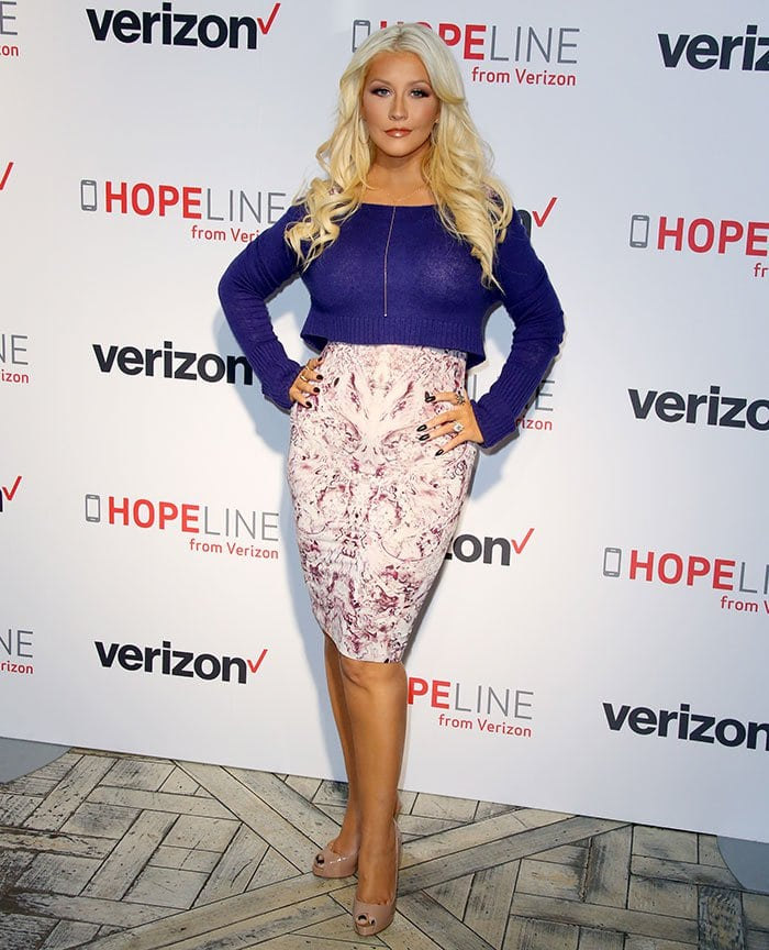 Christina Aguilera highlighted her famous hourglass figure in an abstract-printed body-con dress from Alexander McQueen's 2012 collection