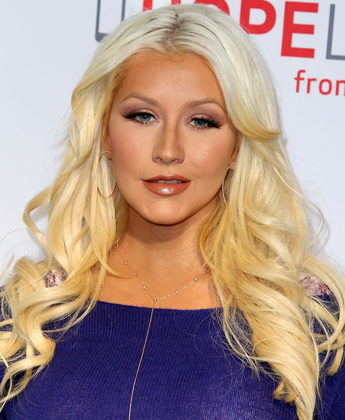 Christina wore her blonde locks down around her shoulders in glamorous curls and sported flawless makeup