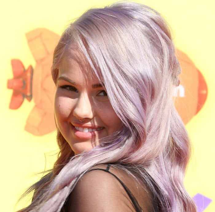 Debby Ryan shows off her lavender hair on the orange carpet of the 2015 Nickelodeon Kids' Choice Awards
