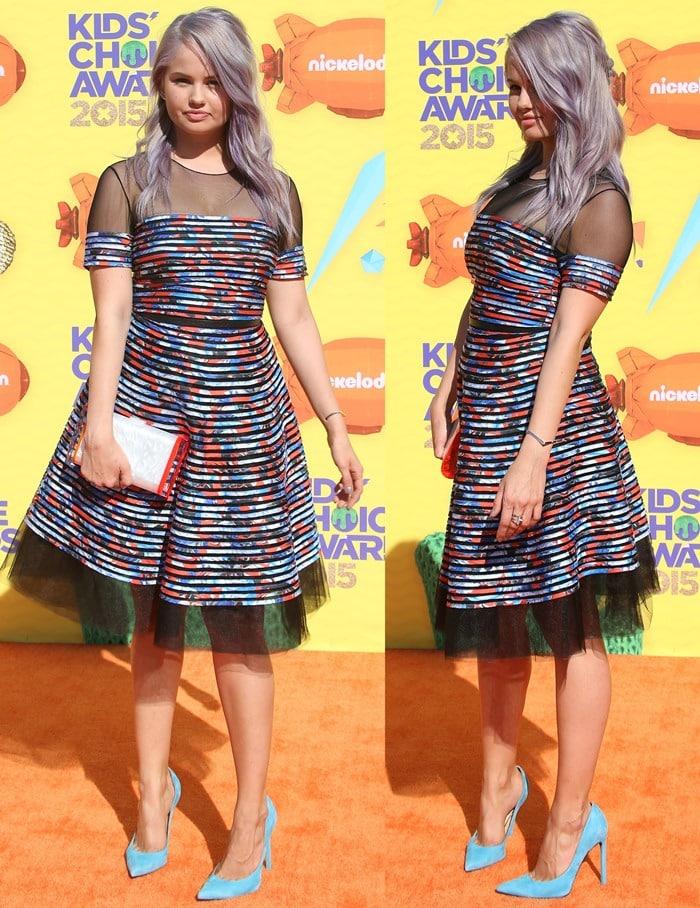 Debby Ryan wears a Sachin + Babi dress on the orange carpet