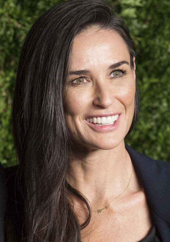 Demi Moore wears her dark hair down at the 2015 CFDA Vogue Fashion Fund Awards