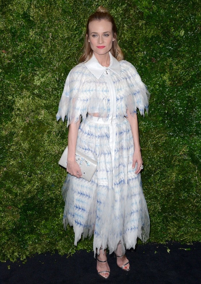 Diane Kruger wears a blue-and-white Chanel dress on the black carpet