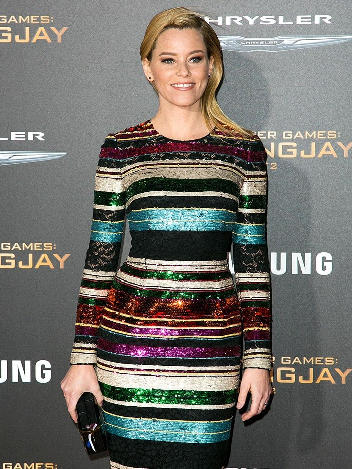 Elizabeth Banks showing support for the recent tragic Paris events with a French flag ribbon on her black Rauwolf clutch