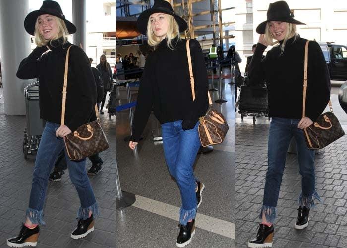 Elle Fanning's black sweater with fringed hem jeans