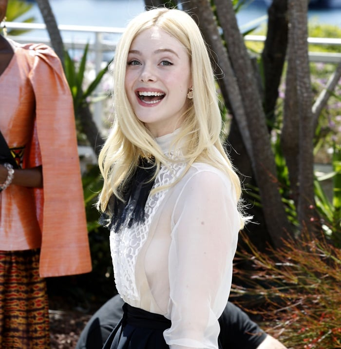 Elle Fanning was thinking about all her money while stepping out for the jury photocall during the 2019 Cannes Film Festival