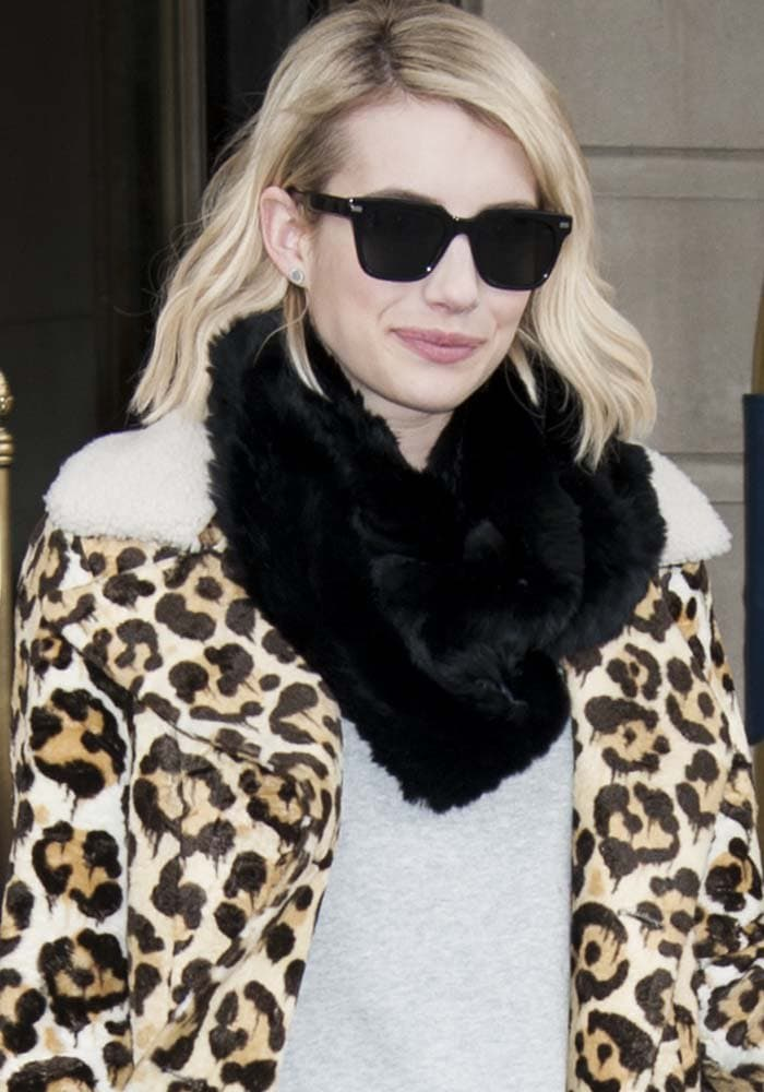 Emma Roberts wears her blonde hair down as she leaves her New York hotel