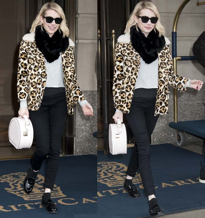 Emma Roberts wears a bold leopard-print jacket as she leaves a hotel in New York