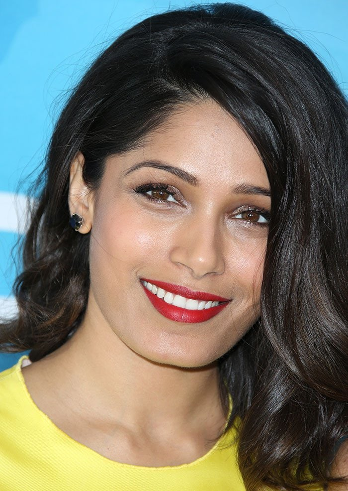 Freida Pinto sported a pop of red in both lipstick and nail polish