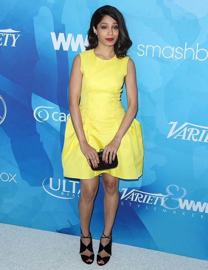 Freida Pinto in a hard-to-ignore neon yellow dress by Roksanda Ilincic
