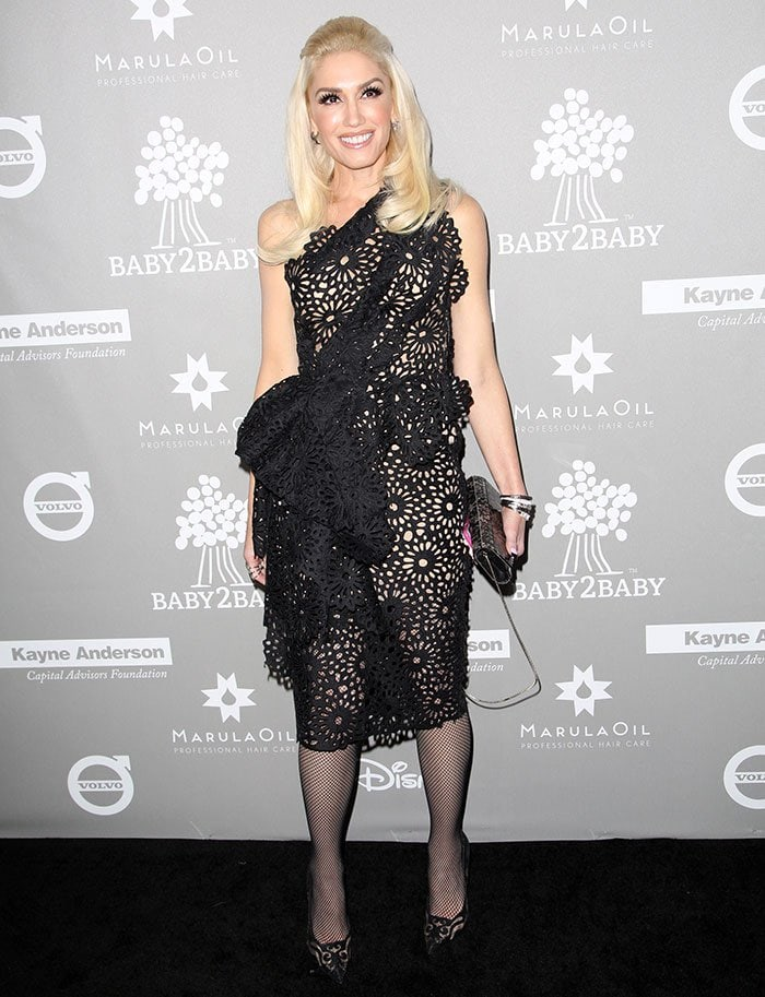 Gwen Stefani poses for photos in a black Marchesa dress