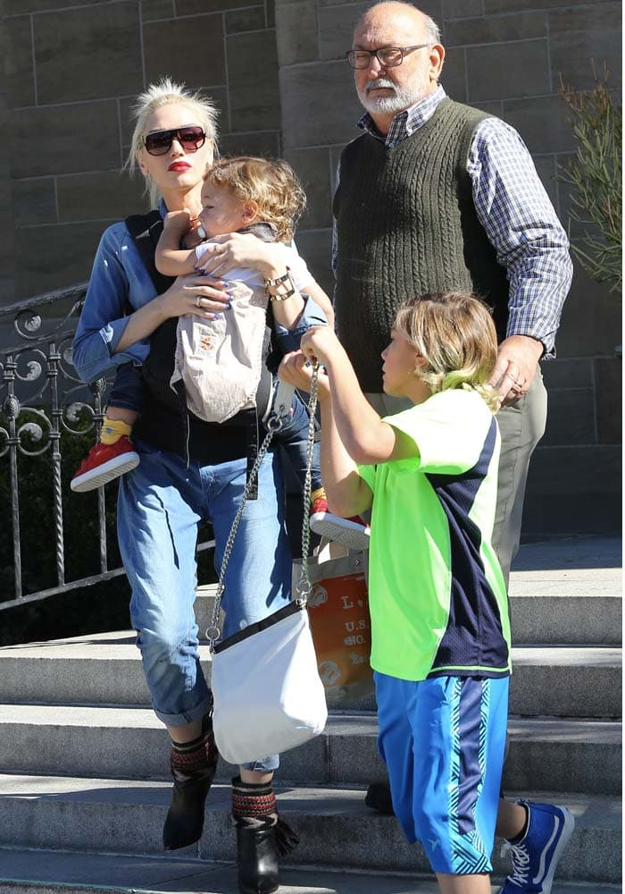 Joined by her father Dennis Stefani, Gwen Stefani takes her three boys, Kingston, Zuma, and Apollo, to Sunday mass at a local churc