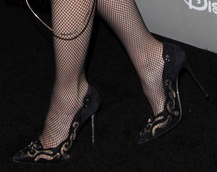 Gwen Stefani's feet in fishnet stockings and Rene Caovilla pumps