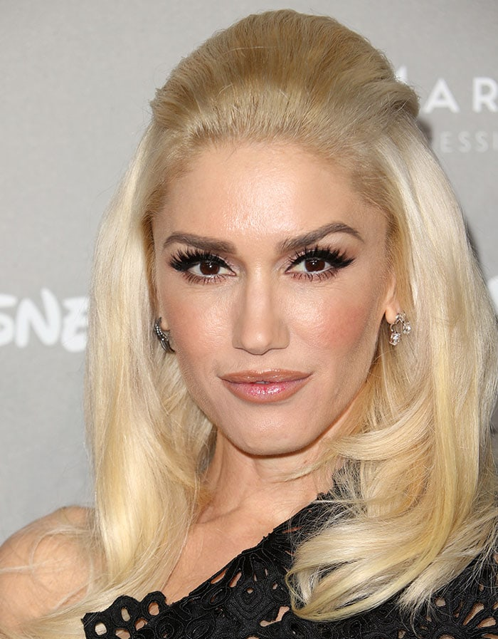 Gwen Stefani wears her platinum blonde hair brushed back at the 2015 Baby2Baby Gala