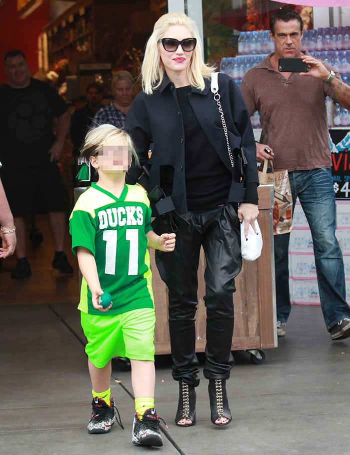 Gwen Stefani wears leather trousers and a black sweater during an outing with her children