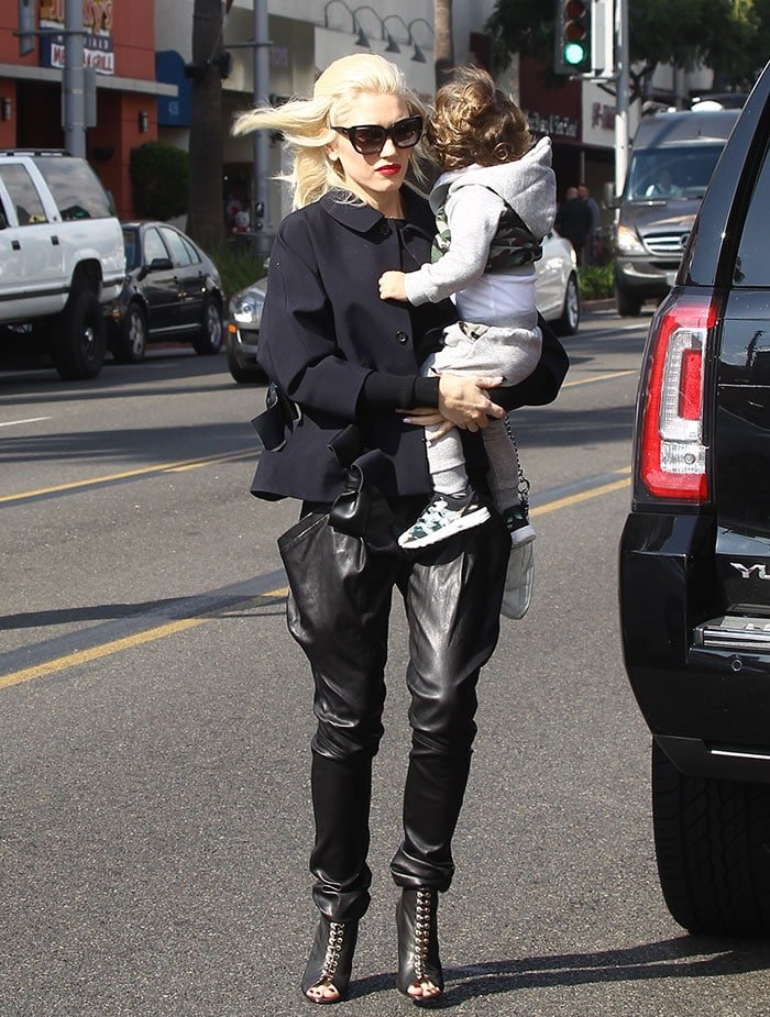 Gwen Stefani holds her son during an outing in Los Angeles
