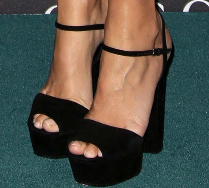 Gwyneth Paltrow wearing black Gucci sandals