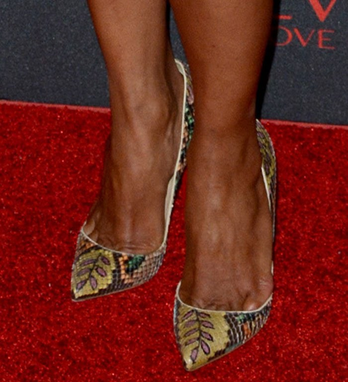 "Halle Berry wearing Christian Louboutin ""Pigalle"" pumps in multicolored printed python"