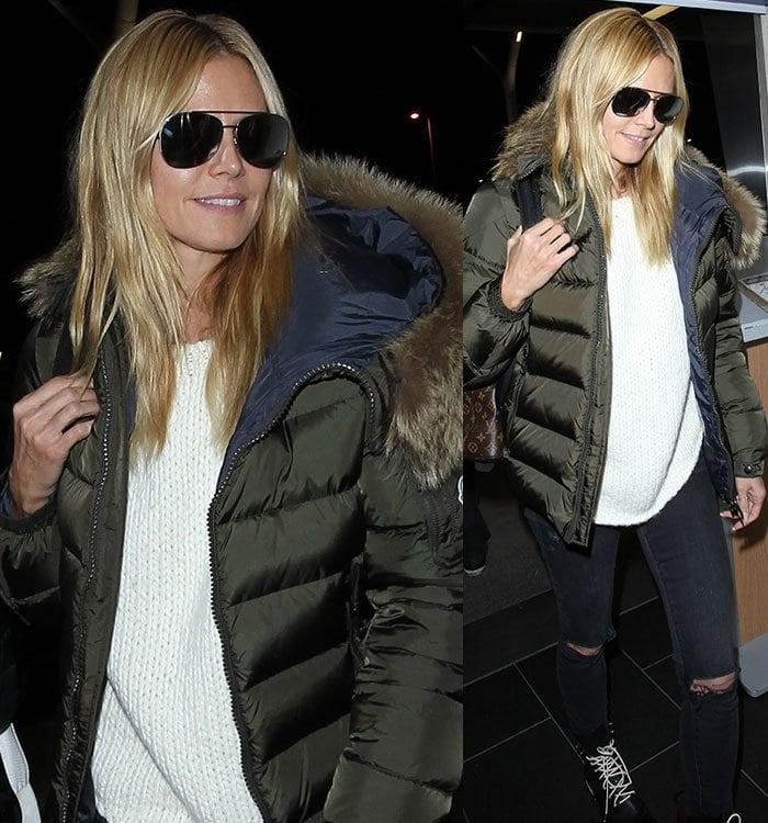 Heidi-Klum-sweater-ripped-jeans-parka-jacket-airport