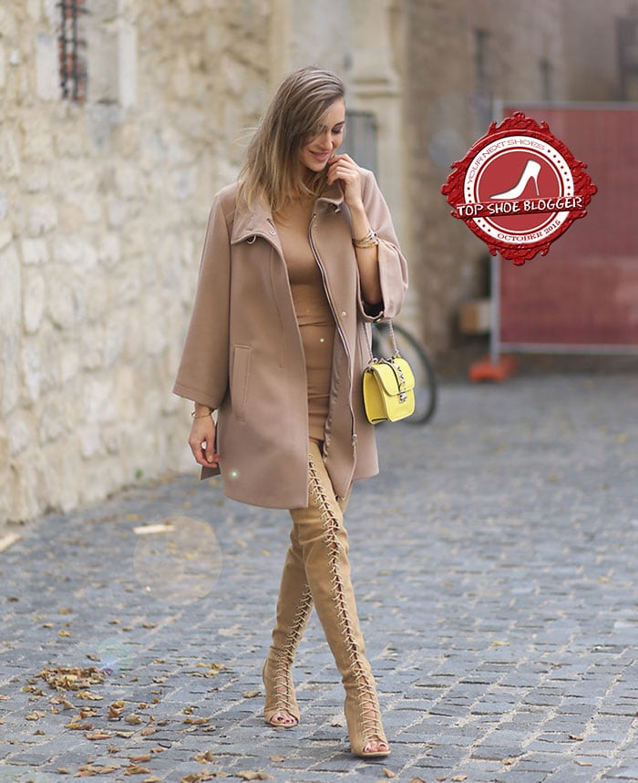 Ioana wore a nude dress with a matching coat and lace-up thigh-high boots