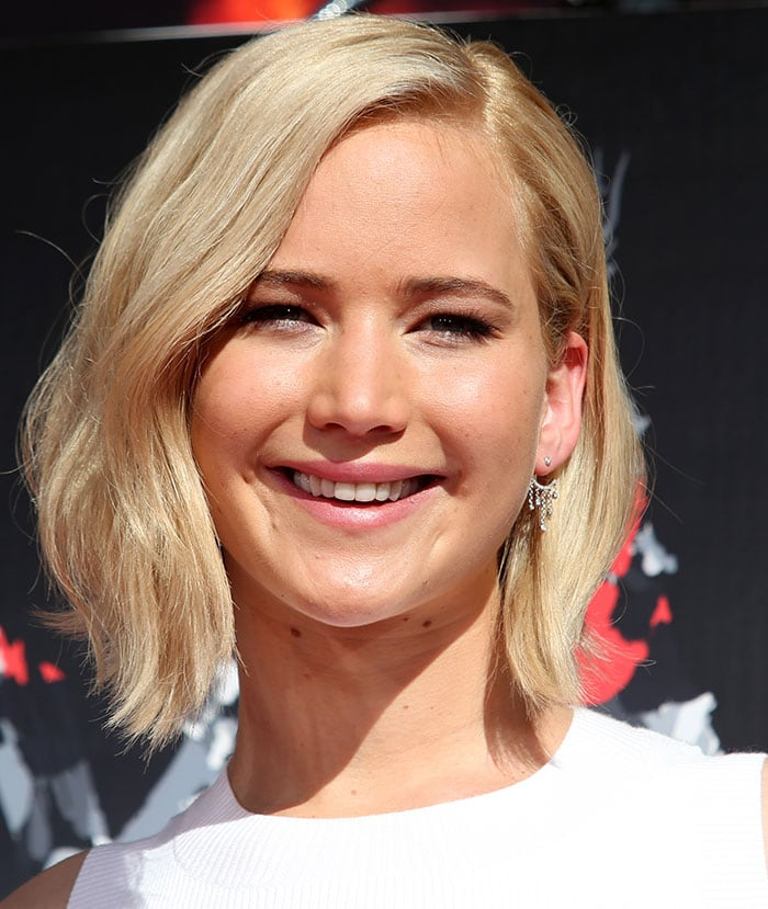 Jennifer Lawrence with a soft wavy bob hairstyle and barely there makeup