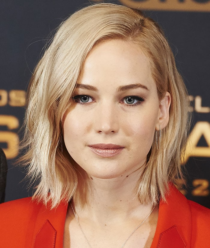 Jennifer Lawrence wore her short platinum blonde locks in tousled waves with a side parting