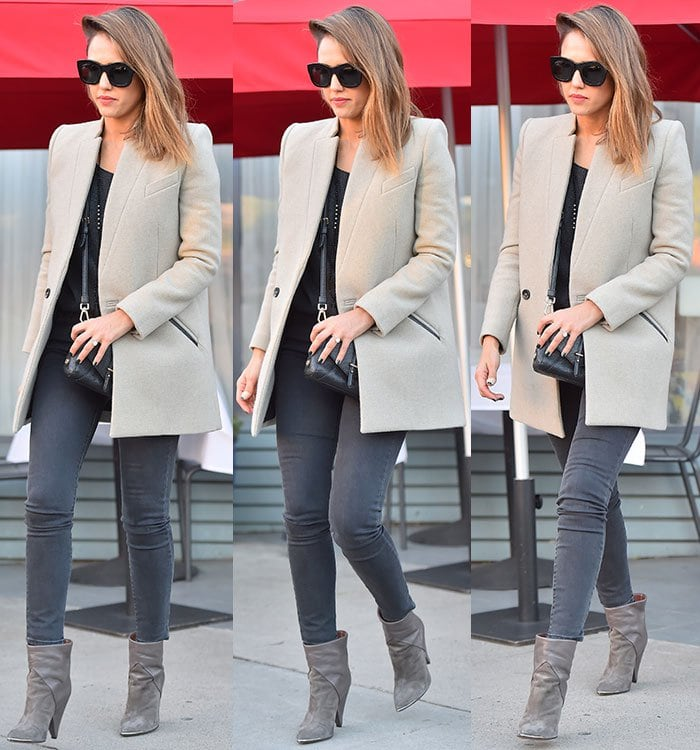 Jessica Alba wears a Stella McCartney blazer over top of skinny jeans and a black blouse for a birthday celebration