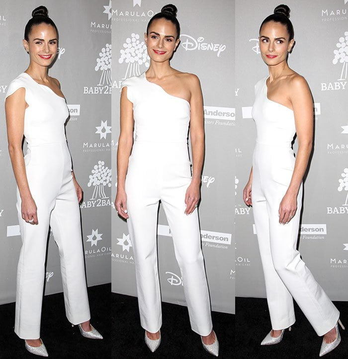 Jordana Brewster wears her hair up and shows off her toned body in a white jumpsuit