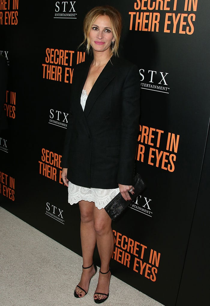 Julia Roberts flaunted her sexy legs and wore her hair up into a messy updo