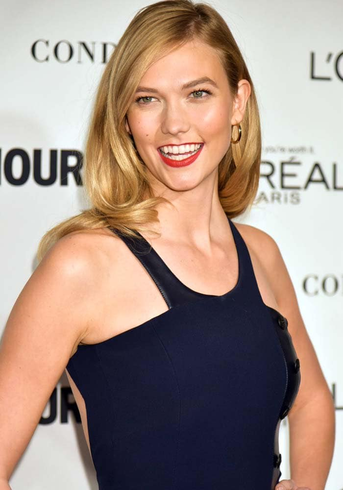 Karlie Kloss keeps her makeup light and wears her blonde hair down