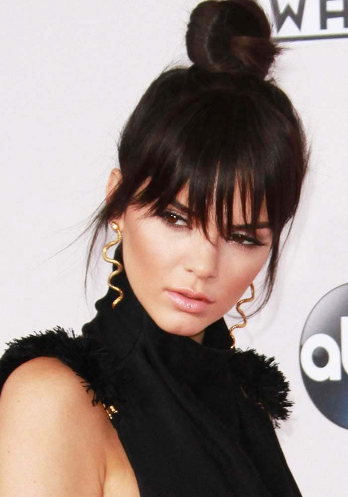 Kendall Jenner debuts her newly-cut hair as she arrives at the American Music Awards
