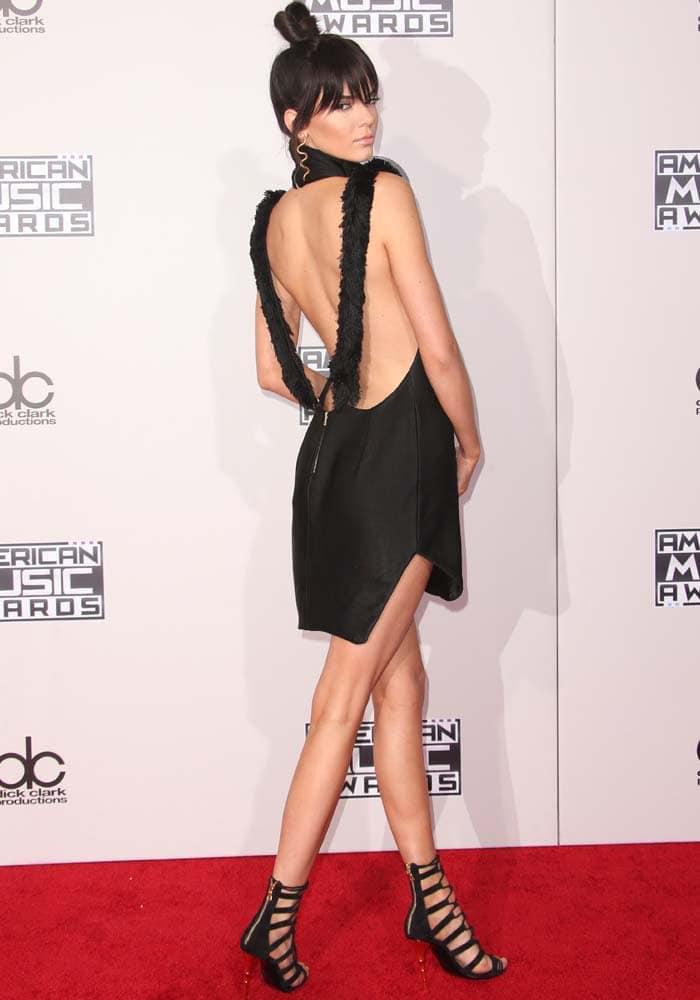 Kendall Jenner shows off her back on the red carpet in an Oriett Domenech dress and Balmain heels