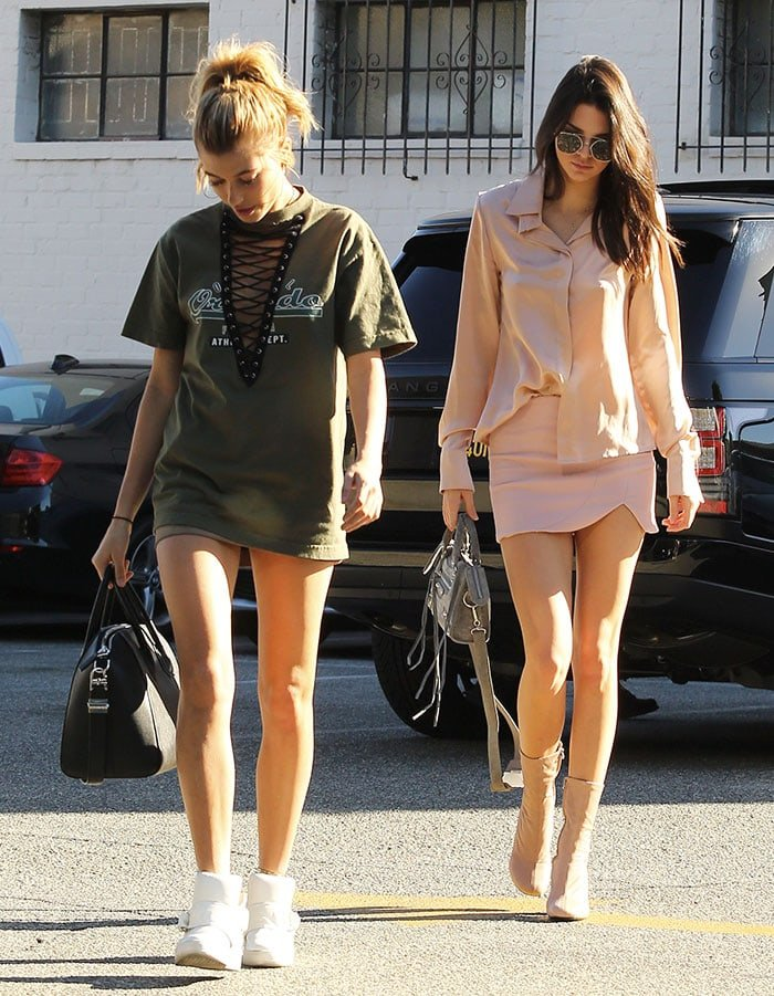 Hailey Baldwin wears a sporty outfit and Kendall Jenner wears a chic outfit as the two spend a day out in Los Angeles