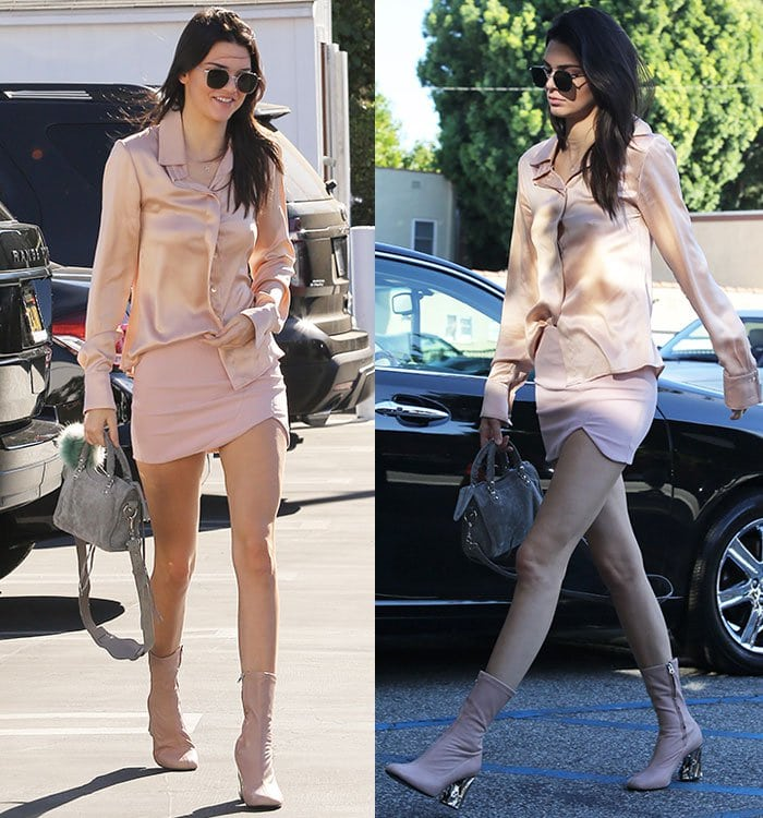 Kendall Jenner wears a light pink blouse, mini skirt, and boots in Los Angeles