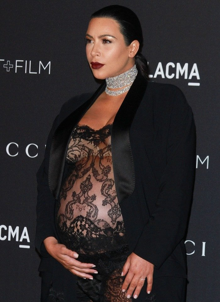 Kim Kardashian in a see-through sheer black lace jumpsuit