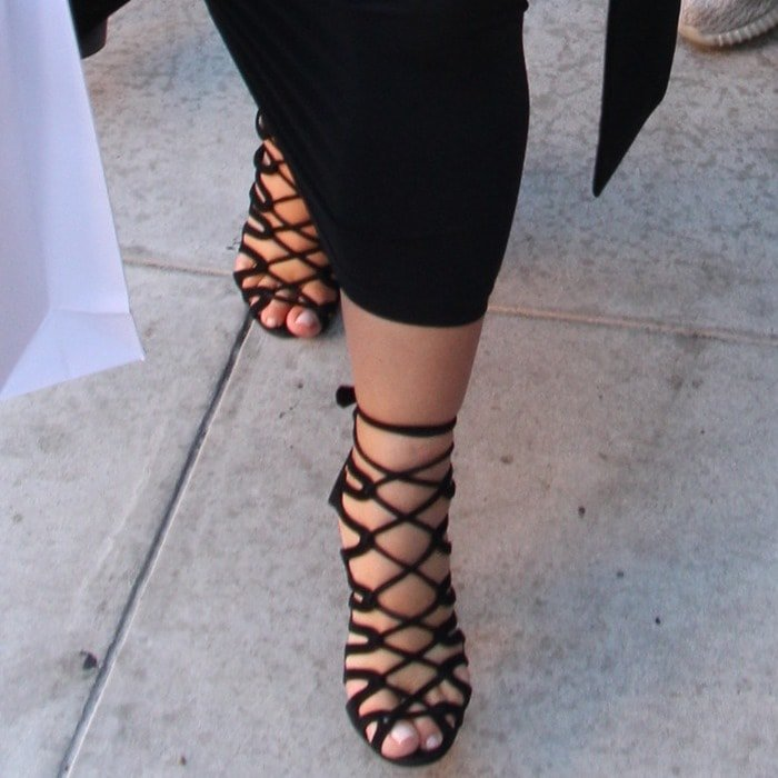Kim wearing strappy Hermès sandals in black