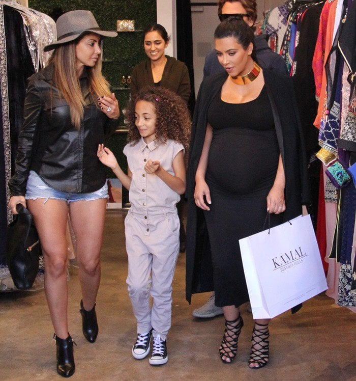 Heavily pregnant Kim Kardashian out shopping at Kamal with Jonathan Cheban and Larsa Pippen in Beverly Hills on November 9, 2015