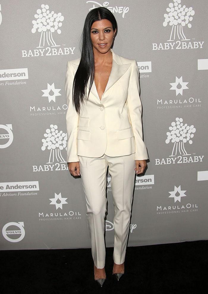 Kourtney Kardashian wears a Dolce & Gabbana pantsuit