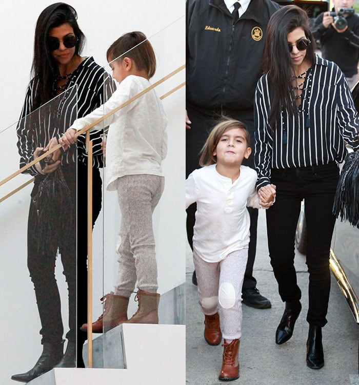 Kourtney Kardashian rocking a loose-fitting black-and-white striped lace-up blouse with tassel details by Faithfull the Brand