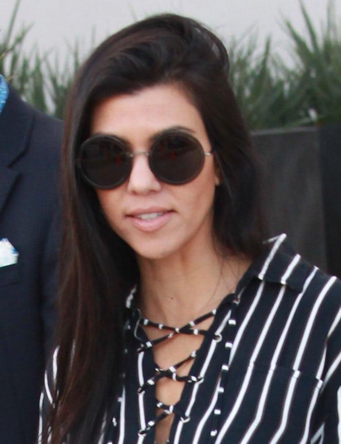 Kourtney Kardashianwore her long dark tresses down