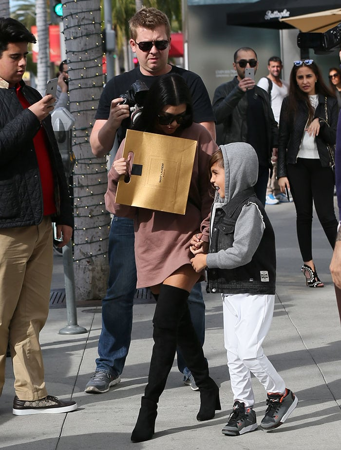 Kourtney Kardashian carries a Yves Saint Laurent shopping bag out in Los Angeles