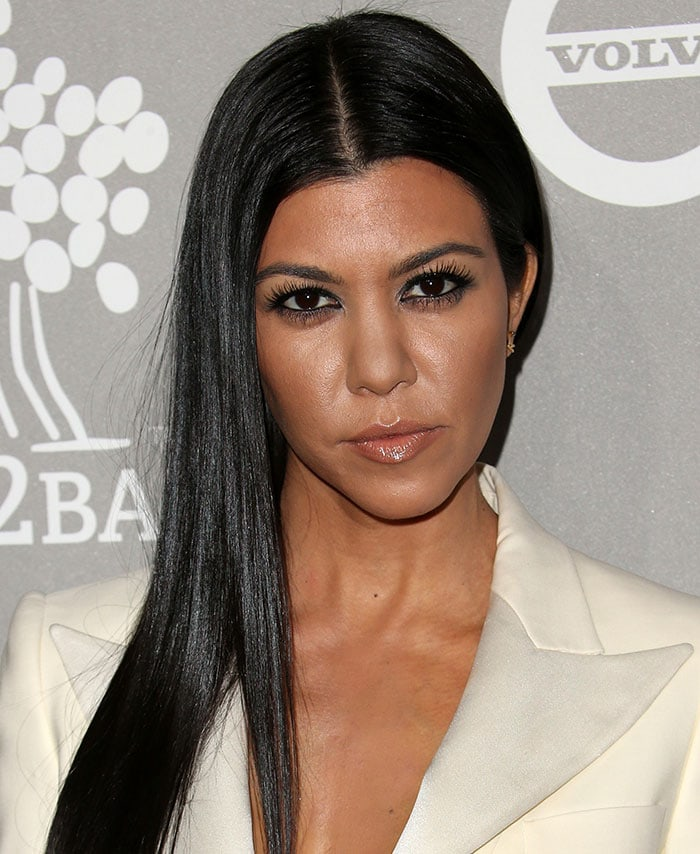 Kourtney Kardashian wears her hair center-parted with nude lip gloss at the 2015 Baby2Baby Gala