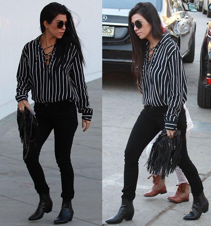 Kourtney Kardashian in a Faithfull the Brand striped top and black jeans