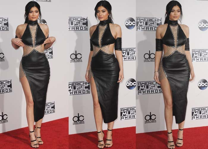 """Kylie wore a leather-and-chains dress from Bryan Hearns, which she paired with a purse from Giuseppe Zanotti, and the Tamara Mellon """"Frontline"""" heels in patent black"""