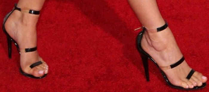 "Kylie Jenner wearing Tamara Mellon ""Frontline"" heels in patent black"