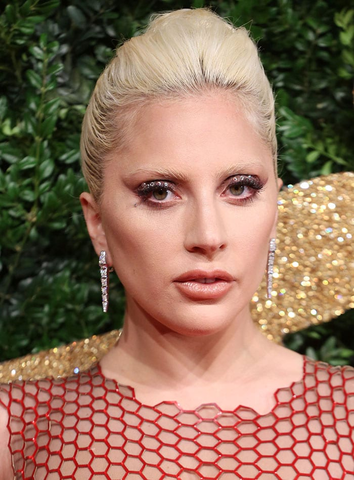 Lady Gaga oozed sex appeal in a custom-made red Tom Ford gown featuring all-over sequin embellishments