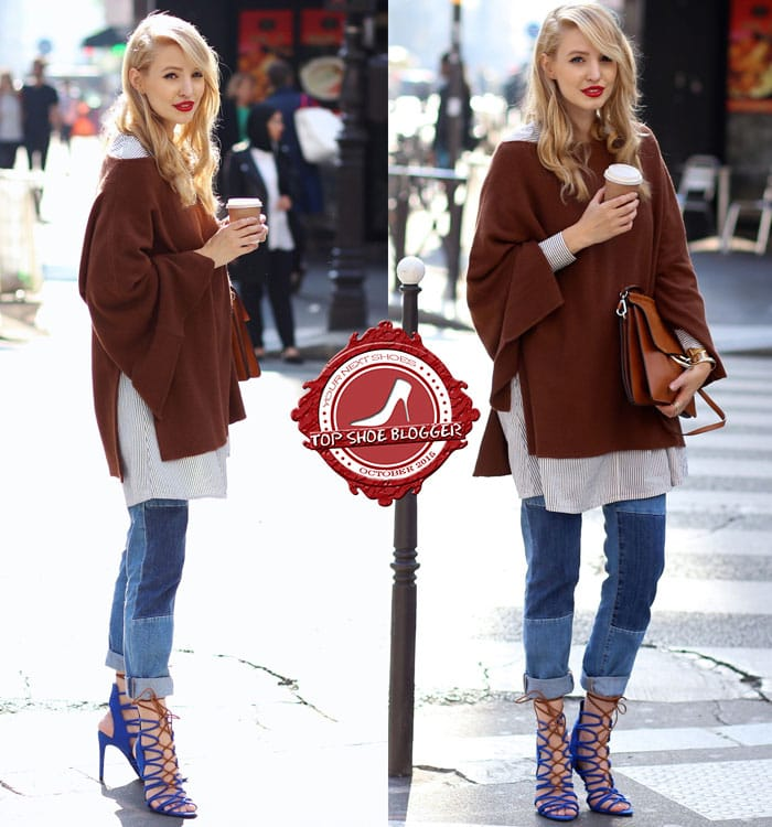 Leonie wore blue heels with a long blouse, a poncho, and patchwork jeans