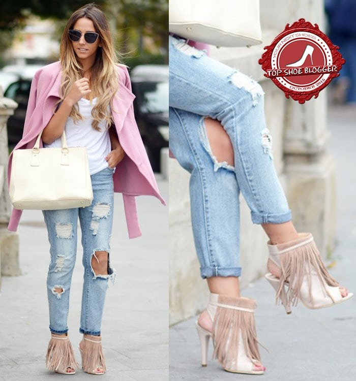 Manuella rocks ripped jeans with fringe booties and a pink coat
