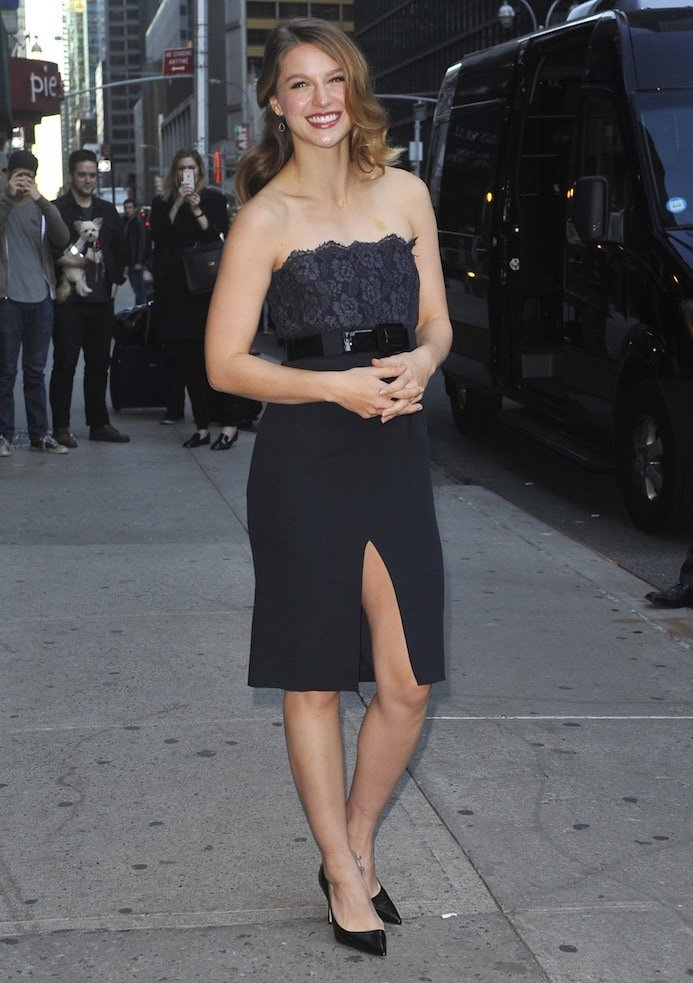 Melissa Benoist wears a strapless black cocktail dress in New York City