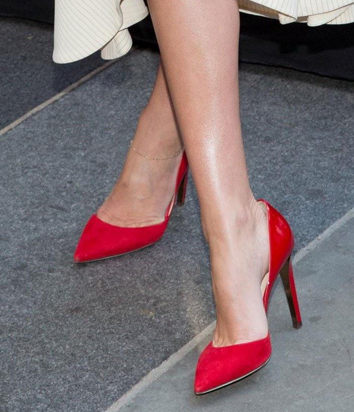 Miranda Kerr reveals toe cleavage in red Jimmy Choo pumps