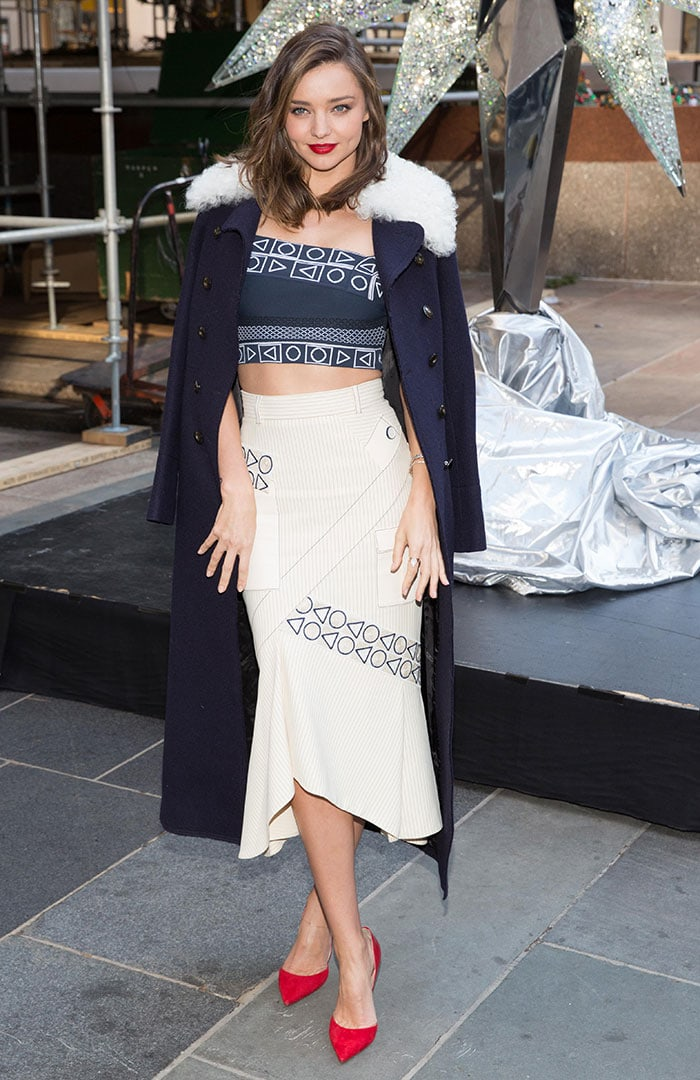 Miranda Kerr covers up in a navy coat with a shearling collar
